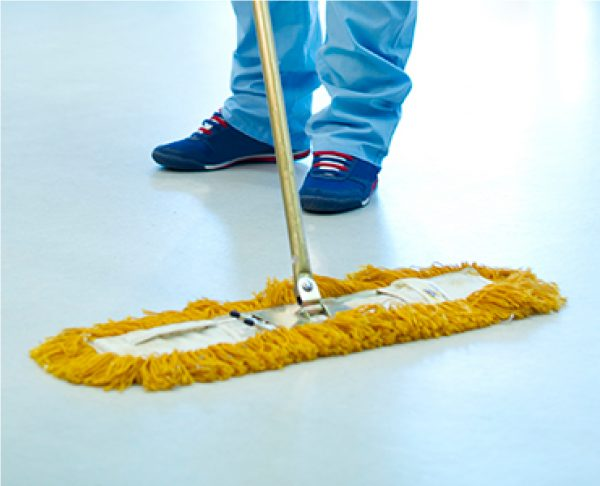 Treated dry mop being used on floor