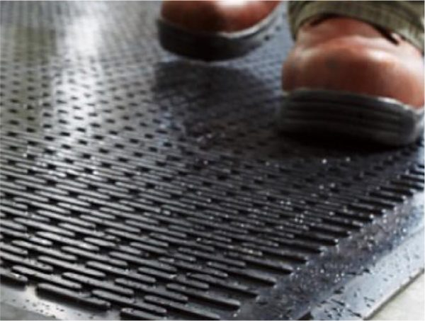 Scraper mat being used by boots