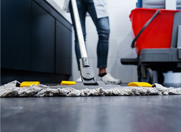 Treated dry mop being used on floor close up