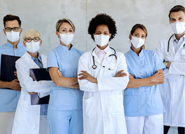 Six people wearing lab, dental and counter coats