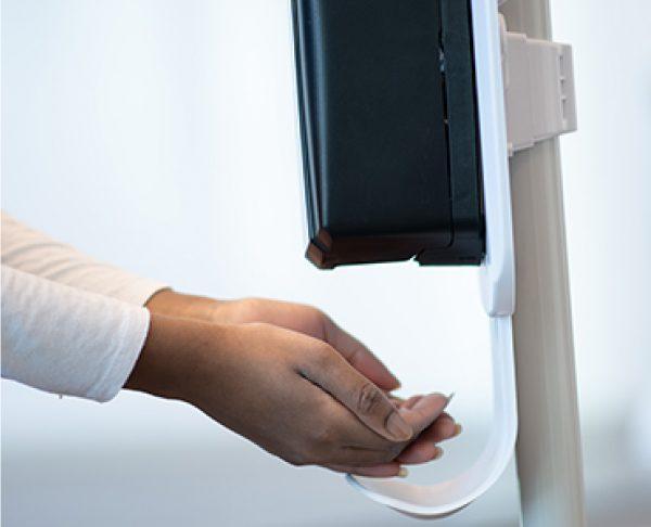 Hand sanitizer dispenser being used