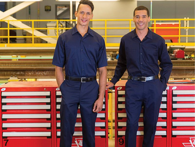 Two men wearing work shirts and work pants