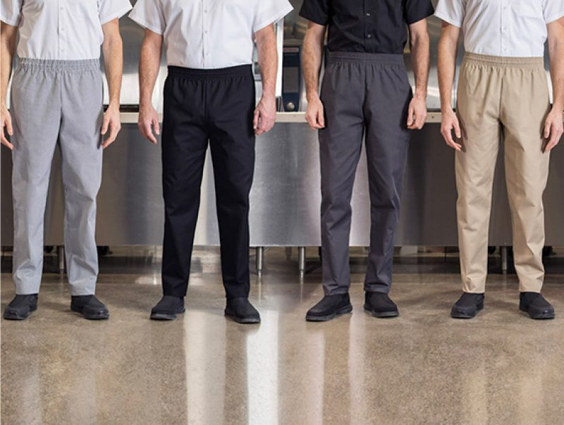 Four people wearing chef pants