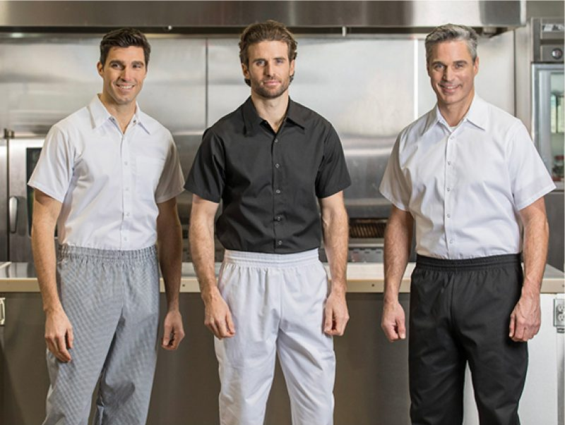 Three men wearing cook shirts and chef pants